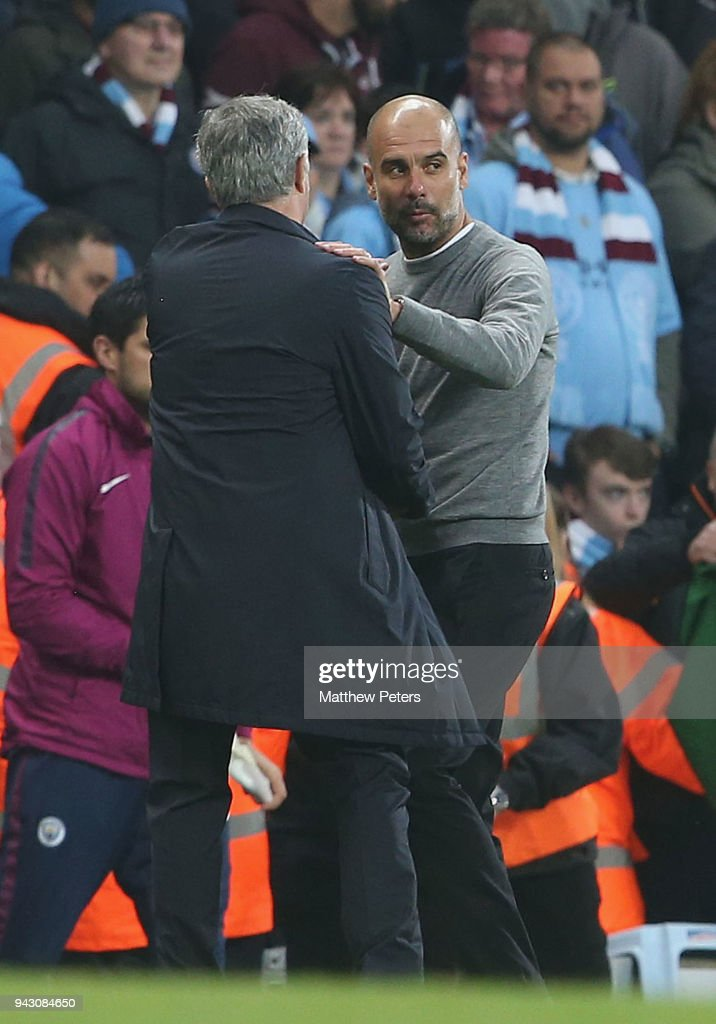 Manager Jose Mourinho of Manchester United and Manager Pep Guardiola of Manchester City shake hands after the Premier League match between Manchester City and Manchester United at Etihad Stadium on April 7, 2018 in Manchester, England.