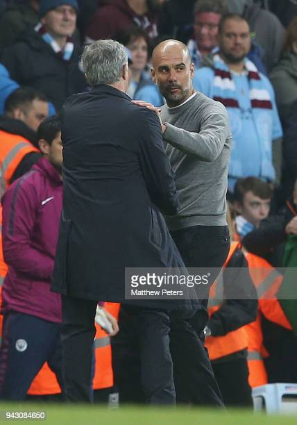 Manager Jose Mourinho of Manchester United and Manager Pep Guardiola of Manchester City shake hands after the Premier League match between Manchester...