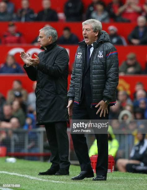 Manager Jose Mourinho of Manchester United and Manager Roy Hodgson of Crystal Palace watch from the touchline the Premier League match between...