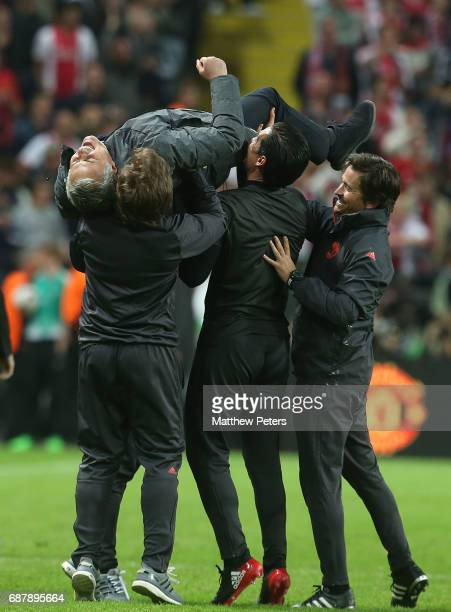 Manager Jose Mourinho of Manchester United celebrates with his coaching staff after the UEFA Europa League Final match between Manchester United and...