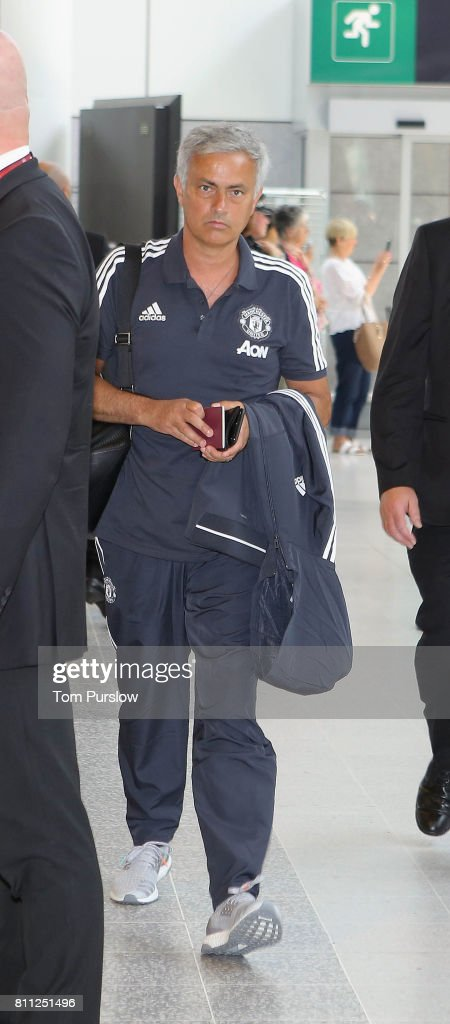 Manager Jose Mourinho of Manchester United checks in at Manchester Airport ahead of the club's pre-season tour of the USA at Manchester Airport on July 9, 2017 in Manchester, England.