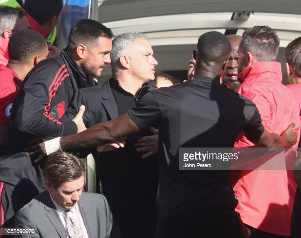 Manager Jose Mourinho of Manchester United clashes with a member of the Chelsea backroom staff during the Premier League match between Chelsea FC and...