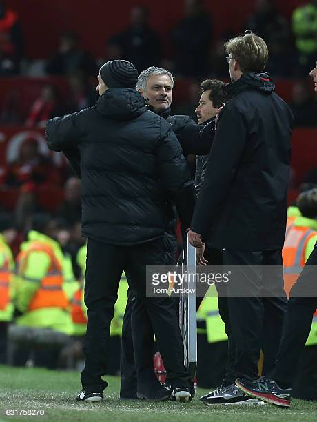 Manager Jose Mourinho of Manchester United clashes with Manager Jurgen Klopp of Liverpool during the Premier League match between Manchester United...
