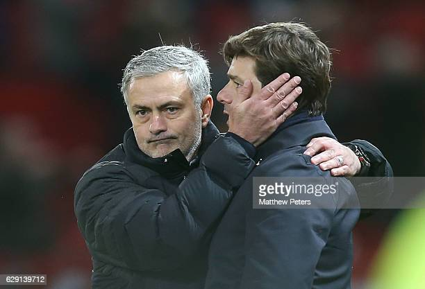 Manager Jose Mourinho of Manchester United commiserates with Manager Mauricio Pochettino of Tottenham Hotspur after the Premier League match between...