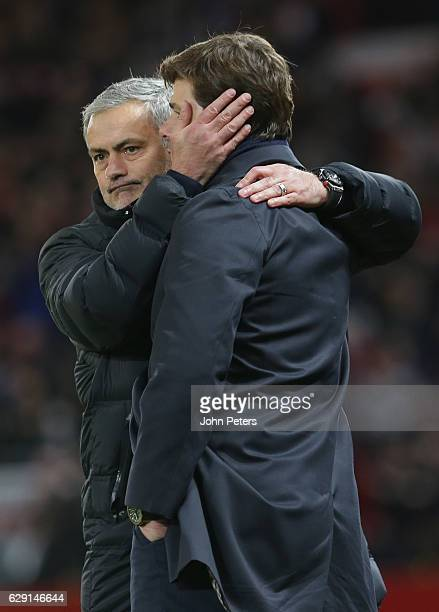 Manager Jose Mourinho of Manchester United commiserates with Manager Mauricio Pochettino after the Premier League match between Manchester United and...