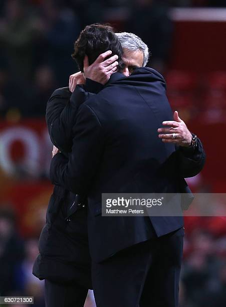Manager Jose Mourinho of Manchester United commiserates with Manager Aitor Karanka of Middlesbrough after the Premier League match between Manchester...