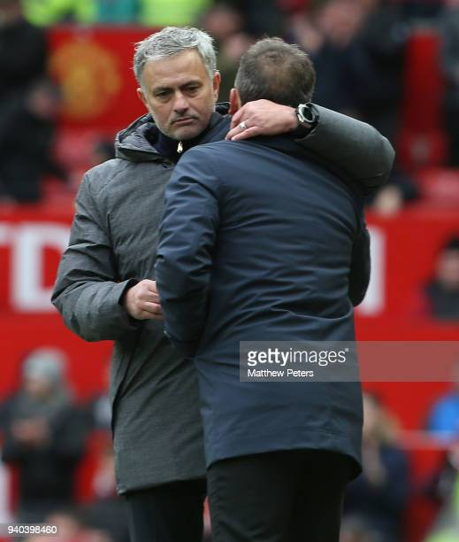 Manager Jose Mourinho of Manchester United commiserates with Manager Carlos Carvalhal of Swansea City during the Premier League match between...