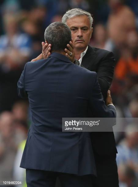 Manager Jose Mourinho of Manchester United congratulates Manager Chris Hughton of Brighton and Hove Albion after the Premier League match between...