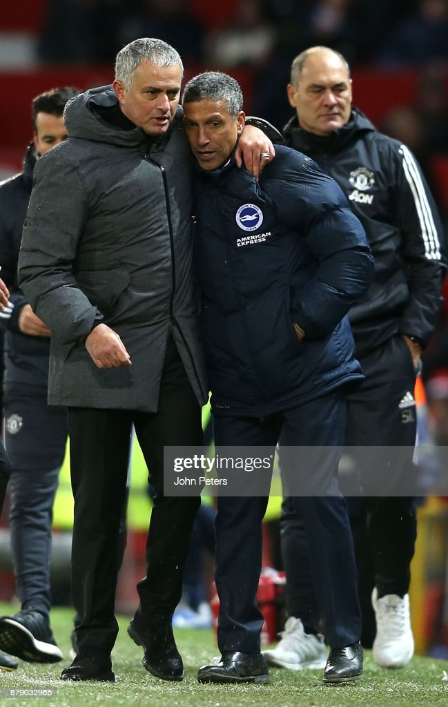 Manager Jose Mourinho of Manchester United embraces Manager Chris Hughton of Brighton and Hove Albion after the Premier League match between Manchester United and Brighton and Hove Albion at Old Trafford on November 25, 2017 in Manchester, England.