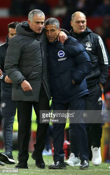 Manager Jose Mourinho of Manchester United embraces Manager Chris Hughton of Brighton and Hove Albion after the Premier League match between...