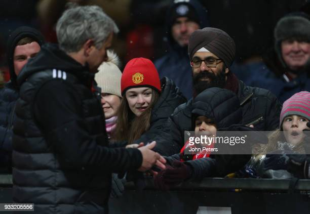 Manager Jose Mourinho of Manchester United gives his hat to a young fan after the Emirates FA Cup Quarter Final match between Manchester United and...