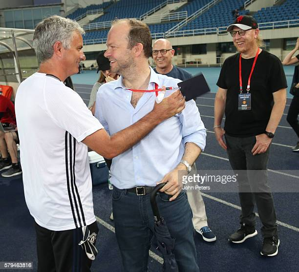 Manager Jose Mourinho of Manchester United greets Executive vicechairman Ed Woodward after a press conference as part of their preseason tour of...