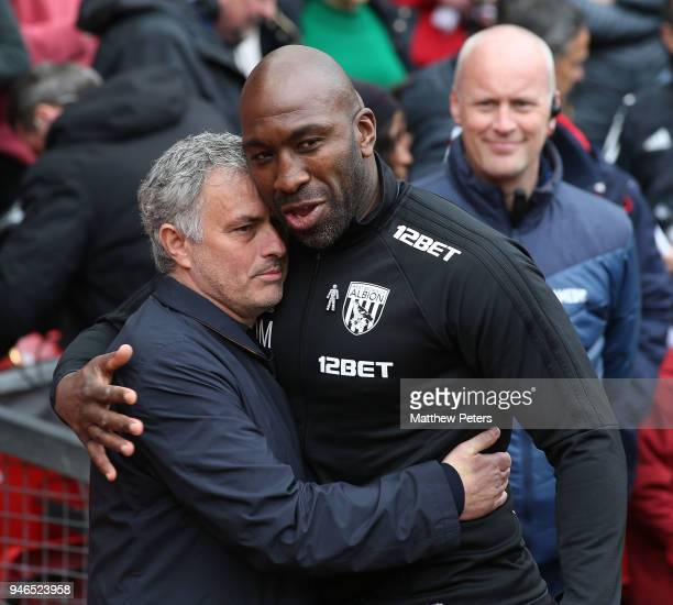 Manager Jose Mourinho of Manchester United greets First Team Coach Darren Moore of West Bromwich Albion ahead of the Premier League match between...