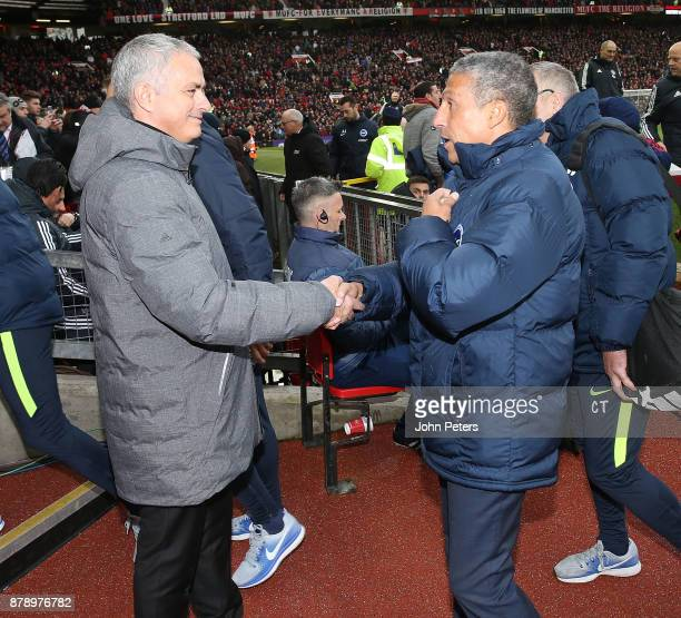 Manager Jose Mourinho of Manchester United greets Manager Chris Hughton of Brighton and Hove Albion ahead of the Premier League match between...