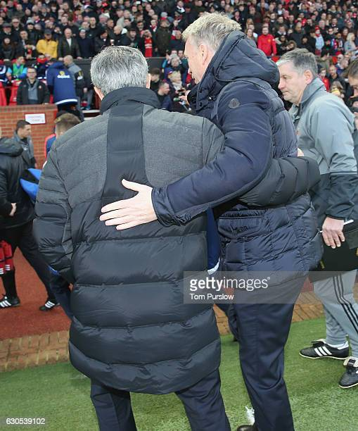 Manager Jose Mourinho of Manchester United greets Manager David Moyes of Sunderland ahead of the Premier League match between Manchester United and...