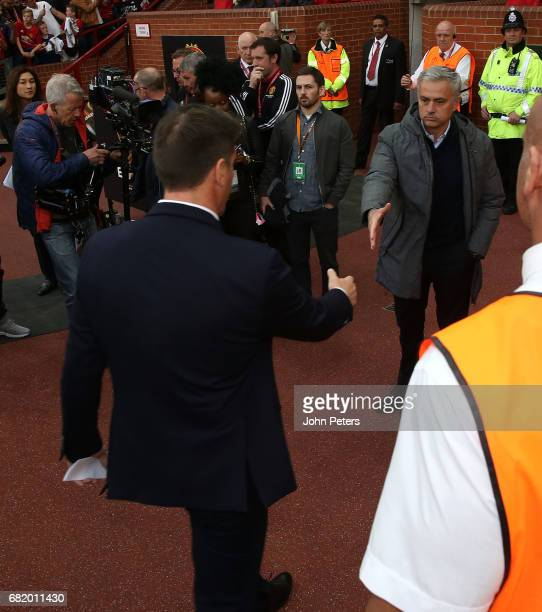 Manager Jose Mourinho of Manchester United greets Manager Eduardo Berizzo of Celta Vigo ahead of the UEFA Europa League semi final second leg match...
