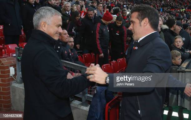 Manager Jose Mourinho of Manchester United greets Manager Marco Silva of Everton ahead of the Premier League match between Manchester United and...