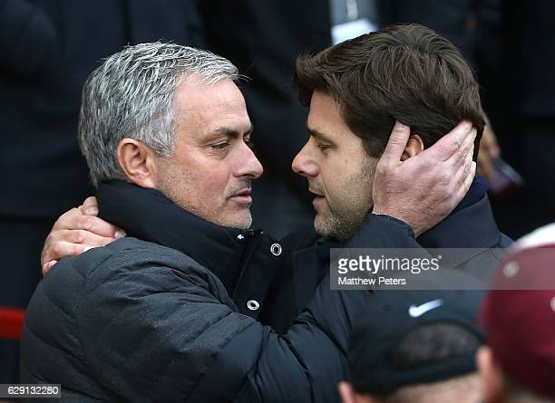 Manager Jose Mourinho of Manchester United greets Manager Mauricio Pochettino of Tottenham Hotspur ahead of the Premier League match between...