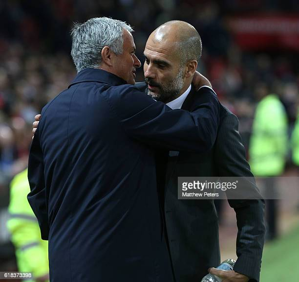 Manager Jose Mourinho of Manchester United greets Manager Pep Guardiola of Manchester City ahead of the EFL Cup Fourth Round match between Manchester...