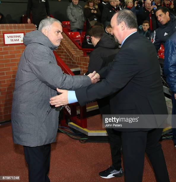 Manager Jose Mourinho of Manchester United greets Manager Rafael Benitez of Newcastle United ahead of the Premier League match between Manchester...