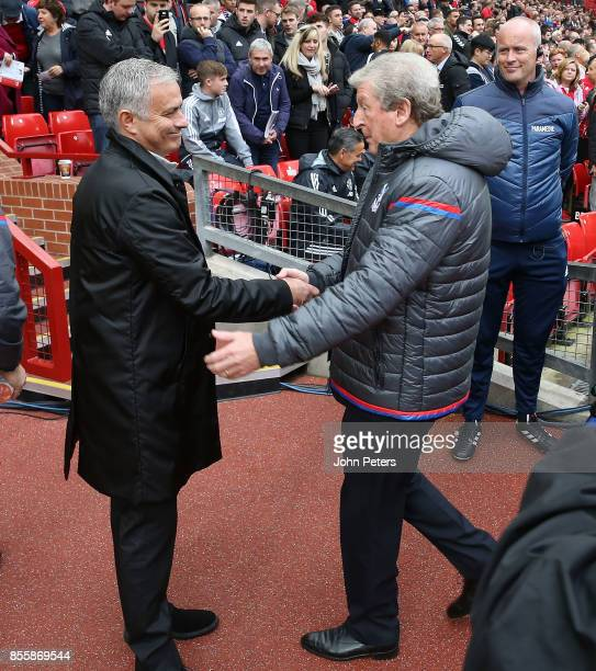 Manager Jose Mourinho of Manchester United greets Manager Roy Hodgson of Crystal Palace ahead of the Premier League match between Manchester United...