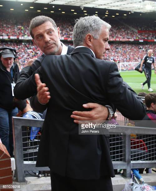 Manager Jose Mourinho of Manchester United greets Manager Slaven Bilic of West Ham United ahead of the Premier League match between Manchester United...