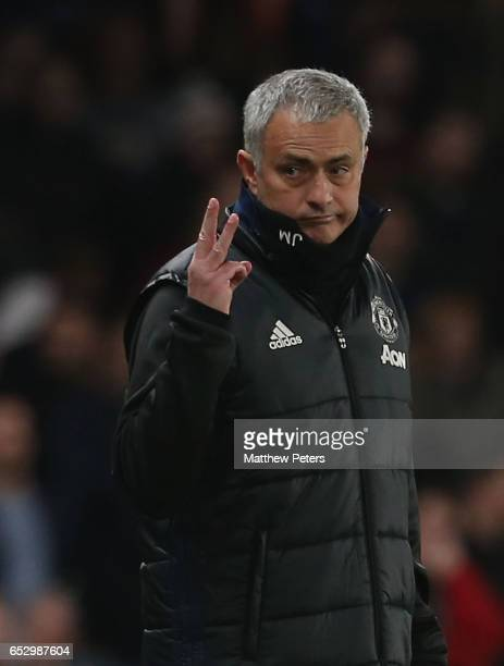 Manager Jose Mourinho of Manchester United holds up three fingers during the Emirates FA Cup QuarterFinal match between Chelsea and Manchester United...