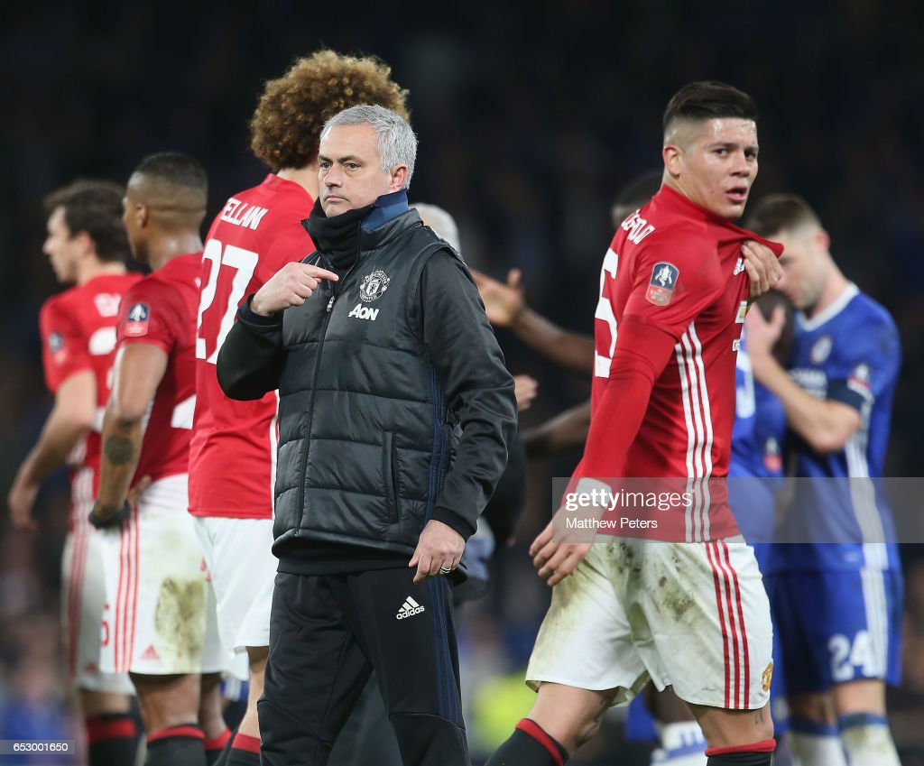 Manager Jose Mourinho of Manchester United points to the club badge after the Emirates FA Cup Quarter-Final match between Chelsea and Manchester United at Stamford Bridge on March 13, 2017 in London, England.