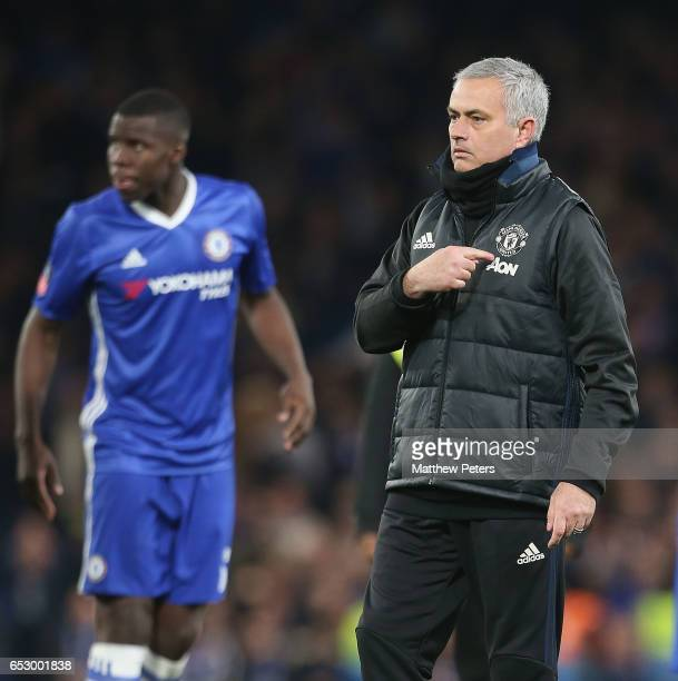 Manager Jose Mourinho of Manchester United points to the club badge after the Emirates FA Cup QuarterFinal match between Chelsea and Manchester...