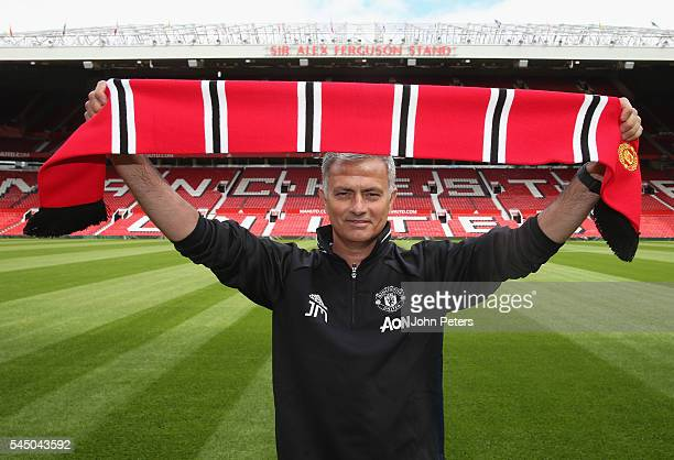 Manager Jose Mourinho of Manchester United poses at Old Trafford after being officially unveiled as Manchester United manager at Old Trafford on July...