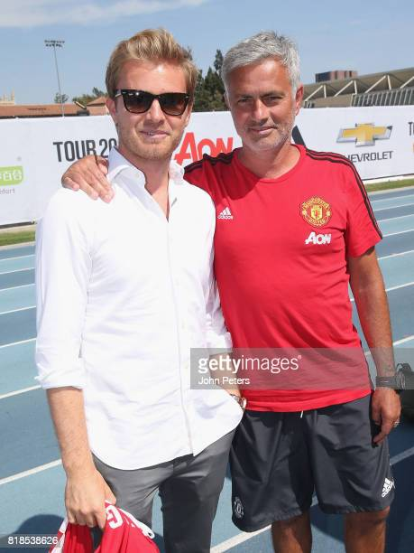 Manager Jose Mourinho of Manchester United poses with Formula One world champion Nico Rosberg ahead of a first team training session as part of their...