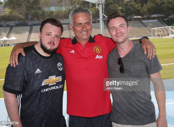Manager Jose Mourinho of Manchester United poses with Game of Thrones actors John BradleyWest and Joe Dempsie ahead of a first team training session...