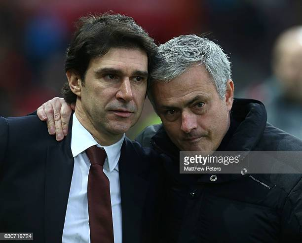 Manager Jose Mourinho of Manchester United poses with Manager Aitor Karanka of Middlesbrough ahead of the Premier League match between Manchester...