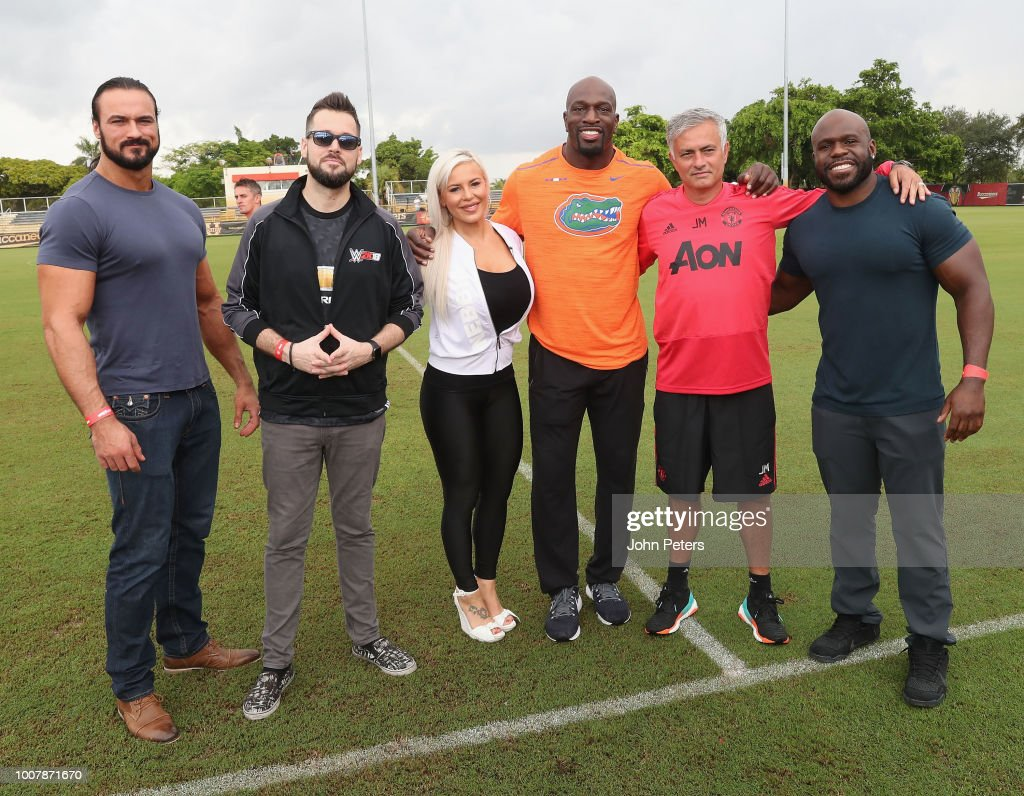 Manager Jose Mourinho of Manchester United poses with WWE announcer Mike Ford and wrestlers Drew McIntyre, Apollo Crews, Dana Brooke and Titus O'Neil after a training session as part of their pre-season tour of the USA at Barry University on July 30, 2018 in Miami, Florida.