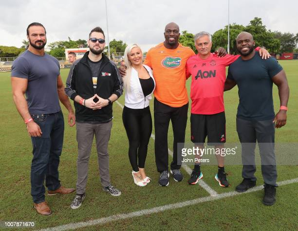 Manager Jose Mourinho of Manchester United poses with WWE announcer Mike Ford and wrestlers Drew McIntyre, Apollo Crews, Dana Brooke and Titus O'Neil...