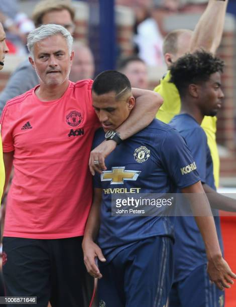 Manager Jose Mourinho of Manchester United puts an arm around Alexis Sanchez after the preseason friendly match between Manchester United and...