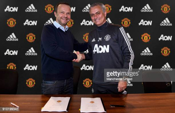 Manager Jose Mourinho of Manchester United shakes hands with Executive ViceChairman Ed Woodward of Manchester United after signing a contract...