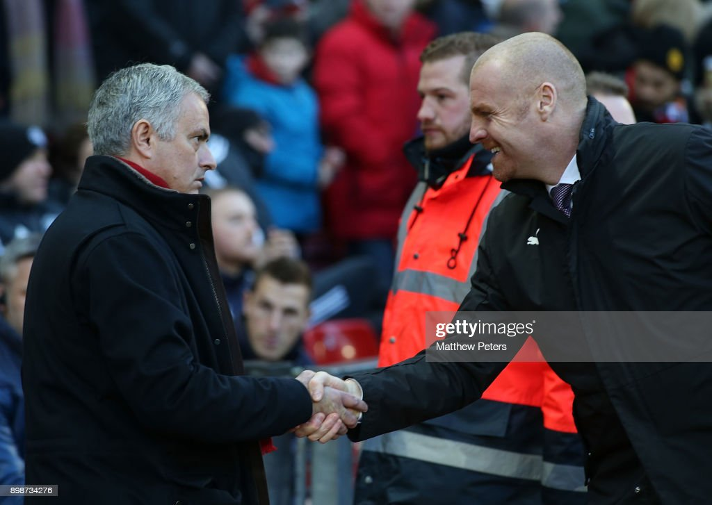Manager Jose Mourinho of Manchester United shakes hands with Manager Sean Dyche of Burnley ahead of the Premier League match between Manchester United and Burnley at Old Trafford on December 26, 2017 in Manchester, England.