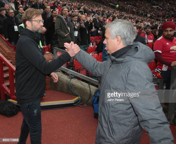 Manager Jose Mourinho of Manchester United shakes hands with Manager Jurgen Klopp of Liverpool ahead of the Premier League match between Manchester...