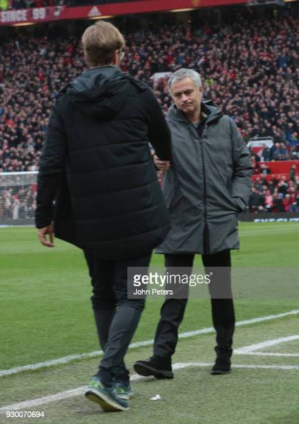 Manager Jose Mourinho of Manchester United shakes hands with Manager Jurgen Klopp of Liverpool after the Premier League match between Manchester...