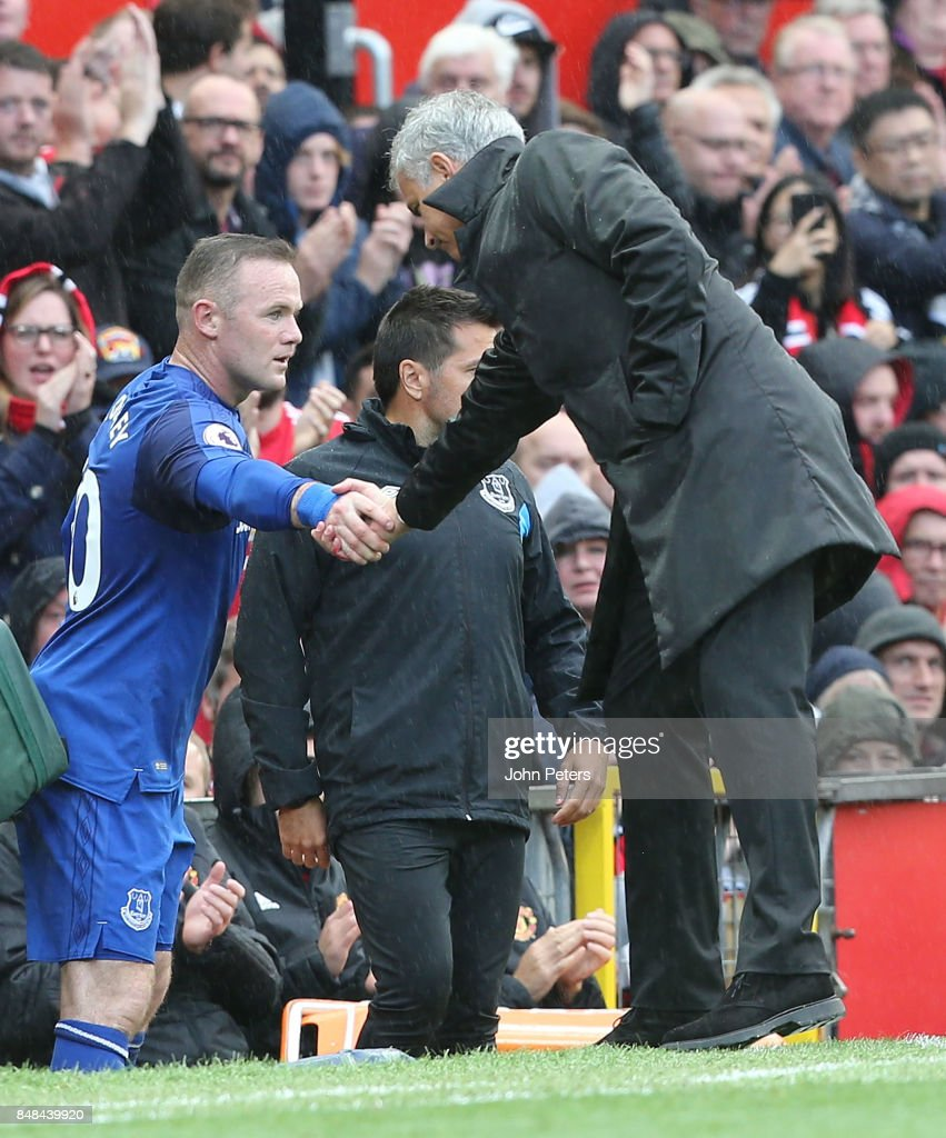 Manager Jose Mourinho of Manchester United shakes hands with Wayne Rooney after the former Manchester United player was substituted during the Premier League match between Manchester United and Everton at Old Trafford on September 17, 2017 in Manchester, England.