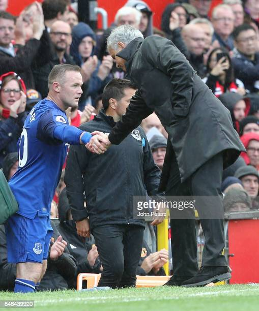 Manager Jose Mourinho of Manchester United shakes hands with Wayne Rooney after the former Manchester United player was substituted during the...