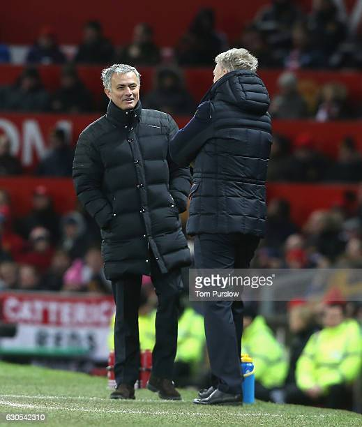 Manager Jose Mourinho of Manchester United shares a joke with Manager David Moyes of Sunderland during the Premier League match between Manchester...