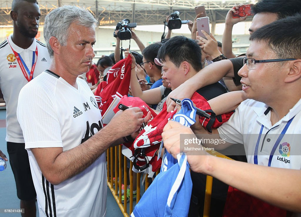 Manager Jose Mourinho of Manchester United signs autographs for fans after a first team training session as part of their pre-season tour of China at Shanghai Stadium on July 21, 2016 in Shanghai, China.