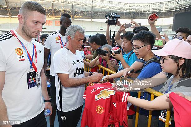 Manager Jose Mourinho of Manchester United signs autographs for fans after a first team training session as part of their preseason tour of China at...