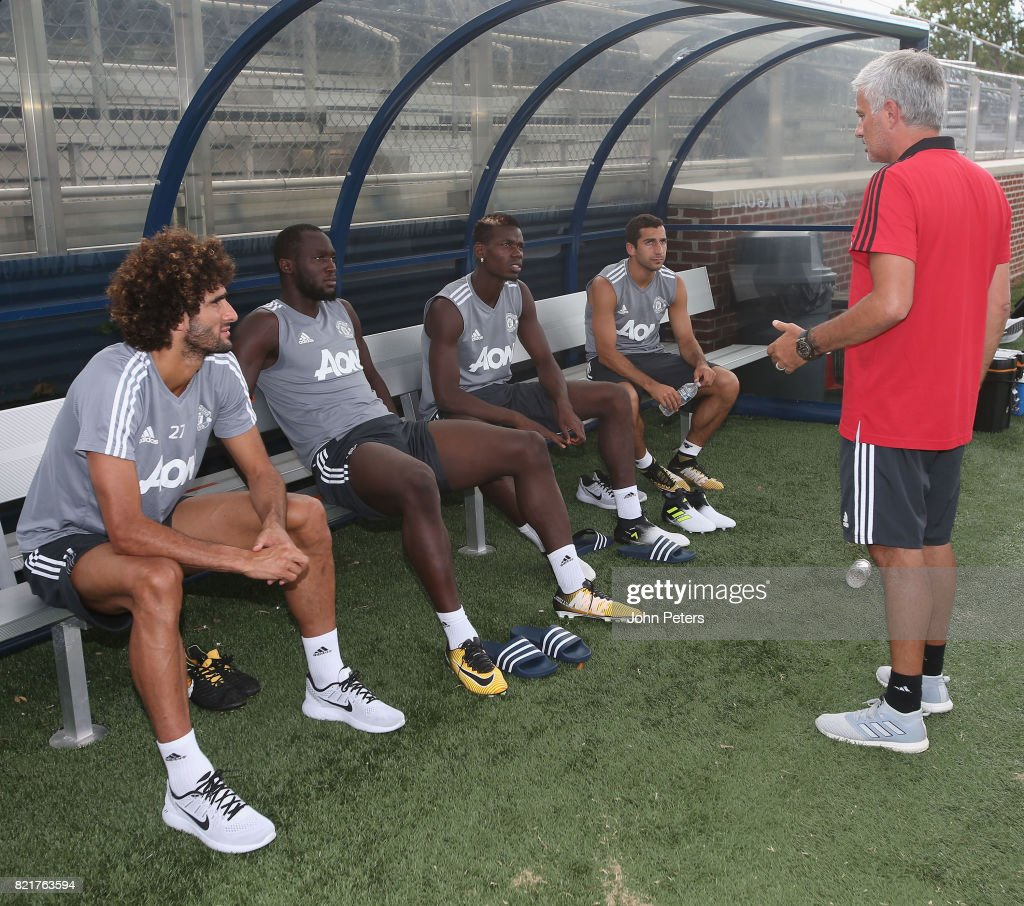 Manager Jose Mourinho of Manchester United speaks to Marouane Fellaini, Romelu Lukaku, Paul Pogba and Henrikh Mkhitaryan during a first team training session as part of their pre-season tour of the USA at Shaw Field on July 24, 2017 in Washington, DC.