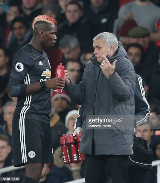 Manager Jose Mourinho of Manchester United speaks to Paul Pogba during the Premier League match between Arsenal and Manchester United at Emirates...