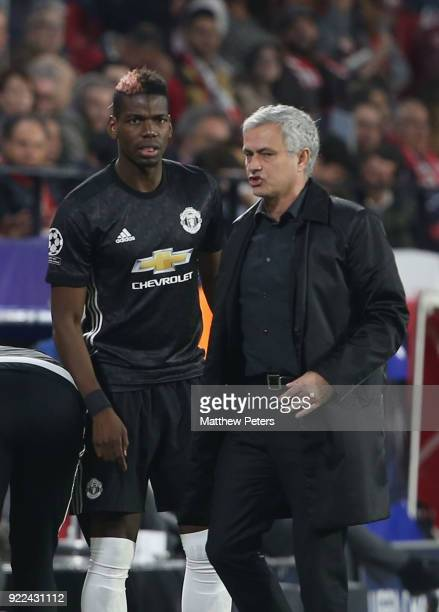 Manager Jose Mourinho of Manchester United speask to Paul Pogba during the UEFA Champions League Round of 16 First Leg match between Sevilla FC and...