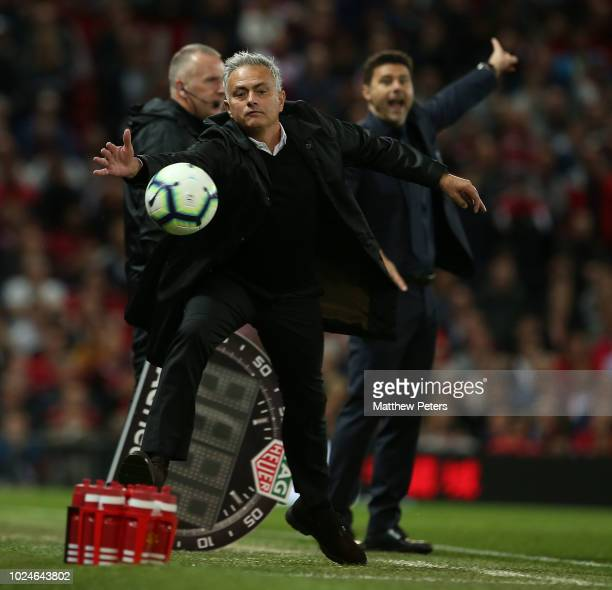 Manager Jose Mourinho of Manchester United stretches for the ball during the Premier League match between Manchester United and Tottenham Hotspur at...