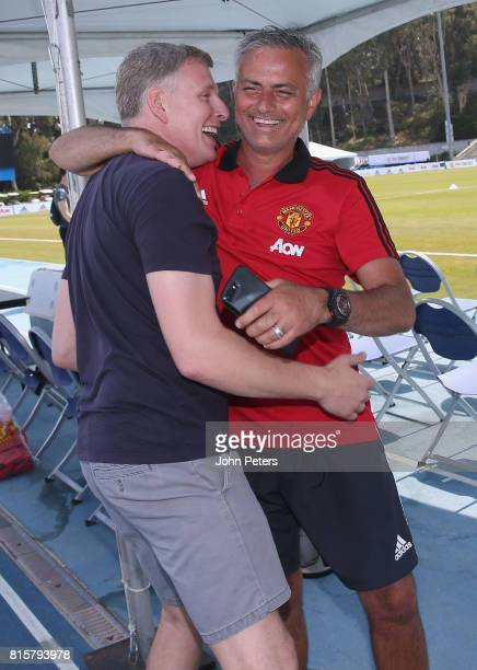 Manager Jose Mourinho of Manchester United talks with comedian Patrick Kielty ahead of a first team training session as part of their preseason tour...